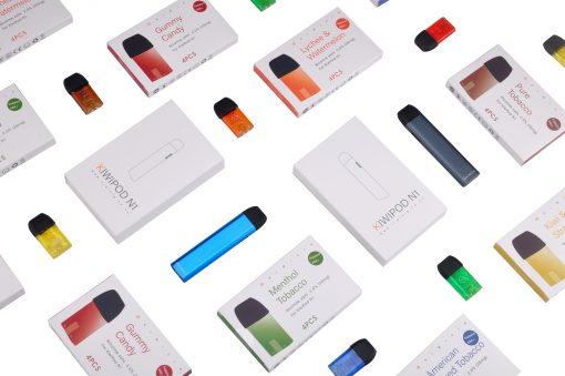 colour vape device batteries surrounded by colorful vape refills